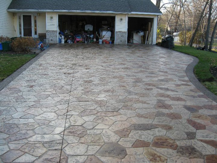 Canyon Stone Driveway With Acid Stained Stones And Exposed Aggregate Border